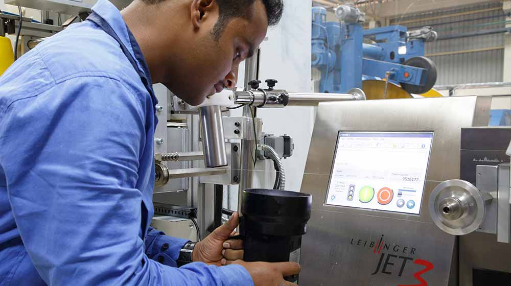 Engineer using state-of-the-art production equipment at Goa factory